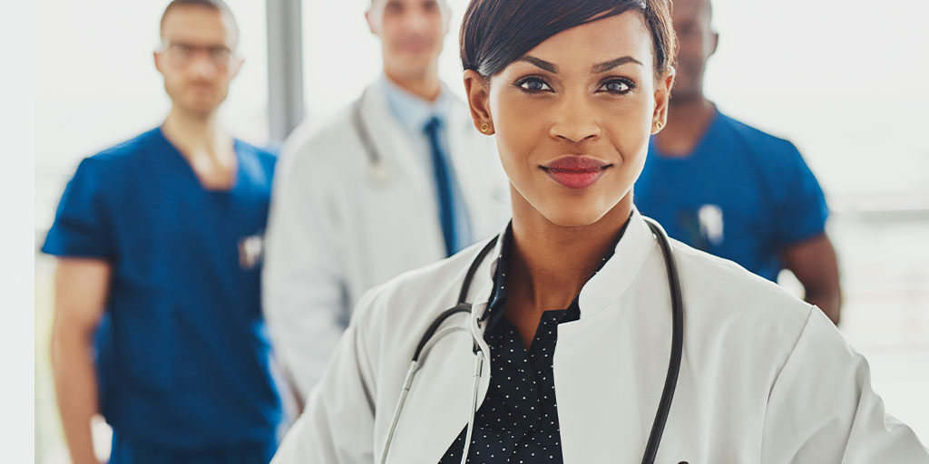 Female doctor in front of other doctors