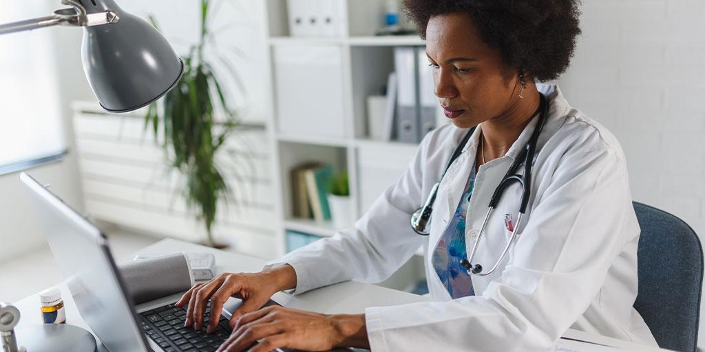 Female doctor on laptop