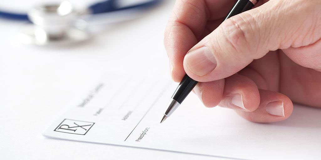 Hand writing prescription on RX pad