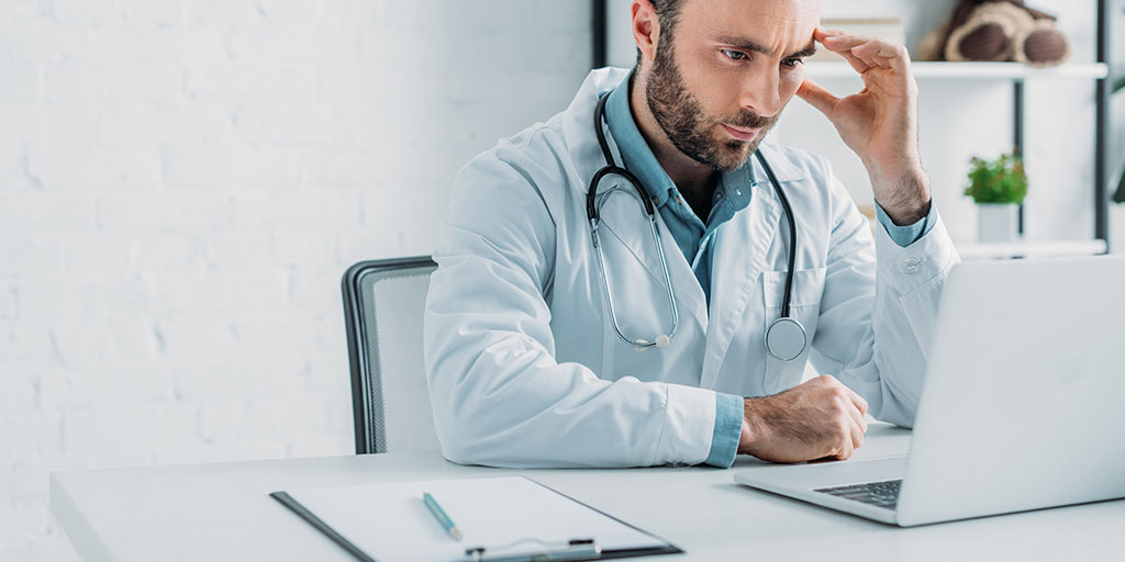 Doctor concentrating hard on computer