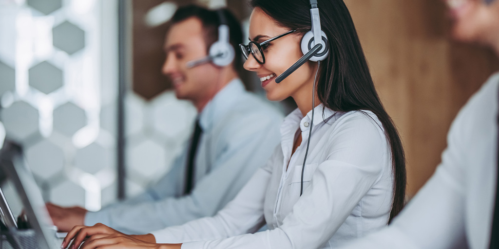 Woman talking to client on headset