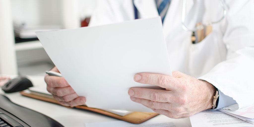 Doctor looking at paperwork
